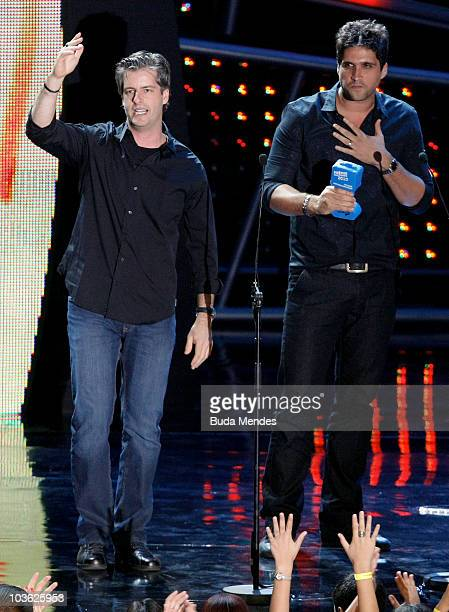 Singers Victor and Leo receive the Best Brazilian country music group award at the 17th Multishow Brazilian Music Awards at the HSBC Arena on August...
