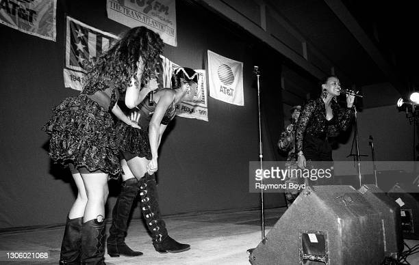 Singers Vivian Ross, Lisa Frazier and Kathy Merrick of Lace and Alyson Williams performs on an army base during the V-103 FM Chicago USO...