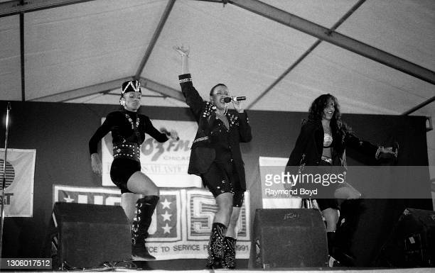 Singers Vivian Ross, Lisa Frazier and Kathy Merrick of Lace performs on an army base during the V-103 FM Chicago USO Trans-Atlantic Jam in Vilseck,...
