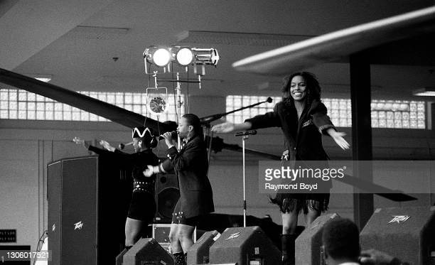 Singers Vivian Ross, Lisa Frazier and Kathy Merrick of Lace performs on an army base during the V-103 FM Chicago USO Trans-Atlantic Jam in Stuttgart,...