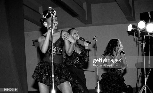 Singers Vivian Ross, Lisa Frazier and Kathy Merrick of Lace performs on an army base during the V-103 FM Chicago USO Trans-Atlantic Jam in...