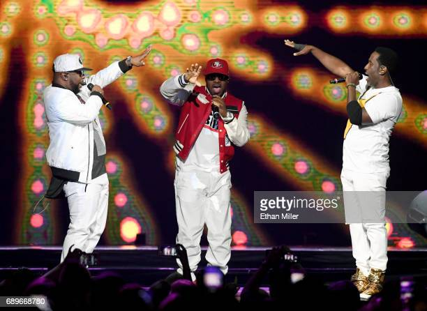 Singers Wanya Morris Nathan Morris and Shawn Stockman of Boyz II Men perform during a stop of The Total Package Tour at TMobile Arena on May 28 2017...