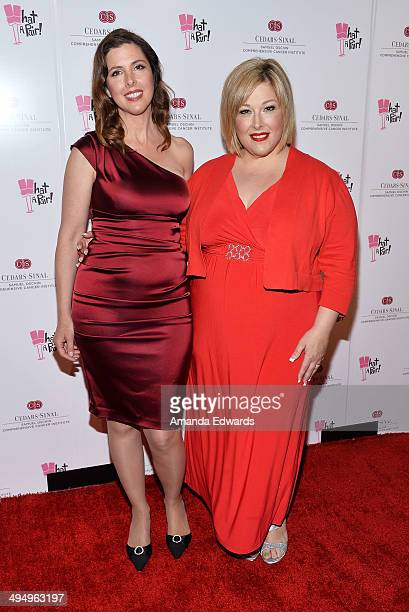 Singers Wendy Wilson and Carnie Wilson arrive at the What A Pair Benefit Concert at the Saban Theatre on May 31 2014 in Beverly Hills California