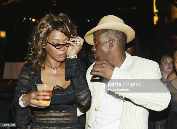 Singers Whitney Houston and husband Bobby Brown attend the VH1 Divas Duets post concert party to benefit the VH1 Save the Music Foundation held at...