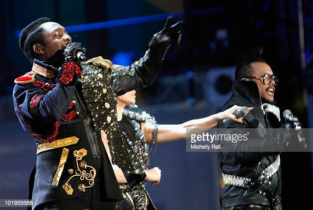 Singers Will.I.Am and Apl.de.ap of the Black Eyed Peas perform on stage during the FIFA World Cup Kick-off Celebration Concert at the Orlando Stadium...