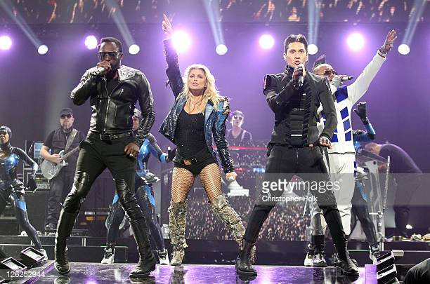 Singers WillIAm Stacy 'Fergie' Ferguson Taboo and apldeap of The Black Eyed Peas perform onstage at the iHeartRadio Music Festival held at the MGM...