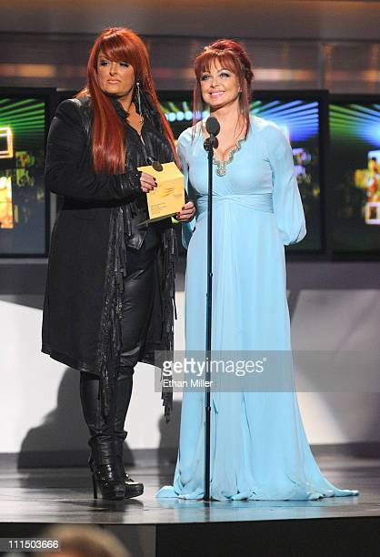 Singers Wynonna Judd and Naomi Judd of The Judds speak onstage at the 46th Annual Academy of Country Music Awards held at the MGM Grand Garden Arena...