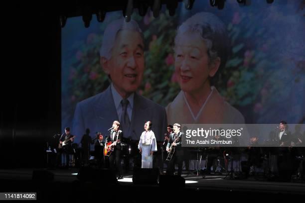 Singers Yumi Matsutoya and Koji Iwasawa and Yujin Kitagawa of Yuzu perform during the ceremony marking Emperor Akihito's 30-year anniversary in...