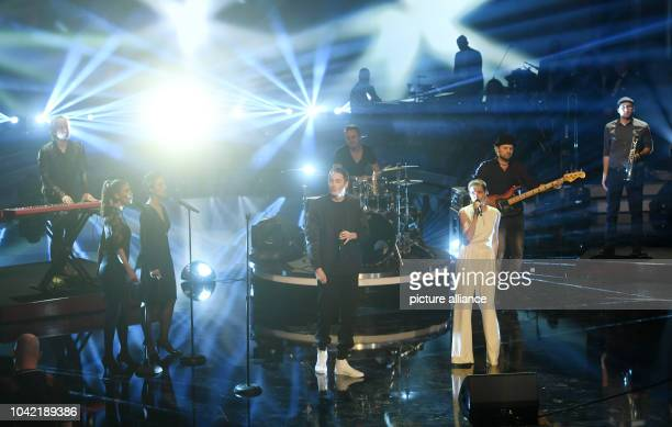 Singers Yvonne Catterfeld and Bengio perform at the Bavarian Film Awards ceremony in the Prinzregenten Theater in Munich Germany 20 January 2017...
