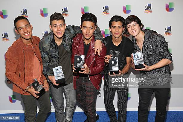 Singers Zabdiel de Jesus, Richard Camacho, Erick Brian Colon, Joel Pimentel and Christopher Velez of CNCO pose with awards at the Univision's 13th...
