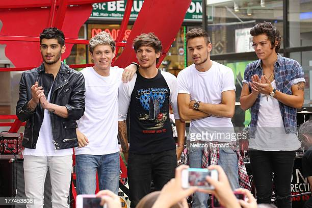 Singers Zayn Malik Niall Horan Louis Tomlinson Liam Payne and Harry Styles from One Direction perform on stage on NBC's 'Today' at Rockefeller Center...
