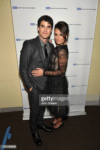 Singers/actors Darren Criss and Lea Michele pose backstage at The Jonsson Cancer Center Foundation's 17th Annual Taste For A Cure Gala held at the...