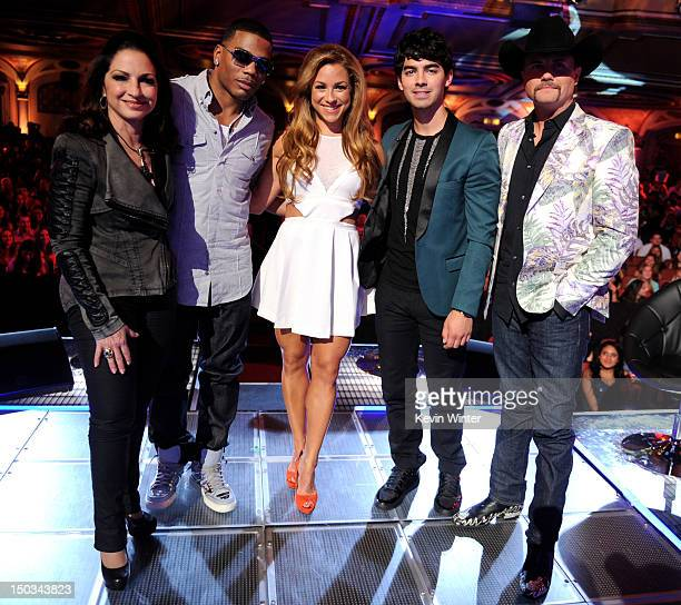Singers/mentors Gloria Estefan Nelly host Allison Hagendorf singers/mentors Joe Jonas and John Rich pose onstage at a taping of The CW's The Next at...