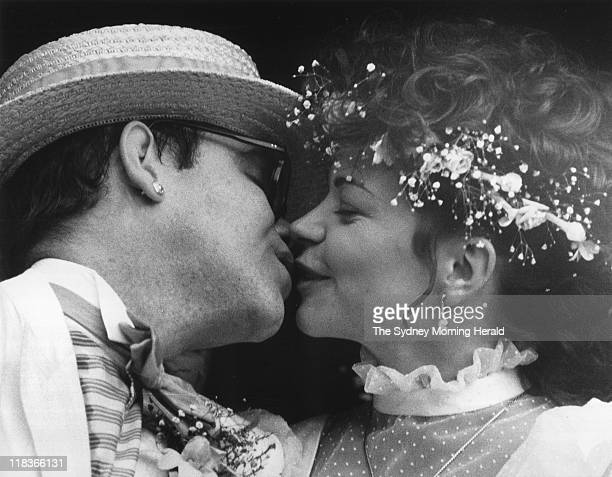 Singersong writer Elton John and German music engineer Renate Blauel kiss after the couple were married at St Marks Church Darling Point on February...