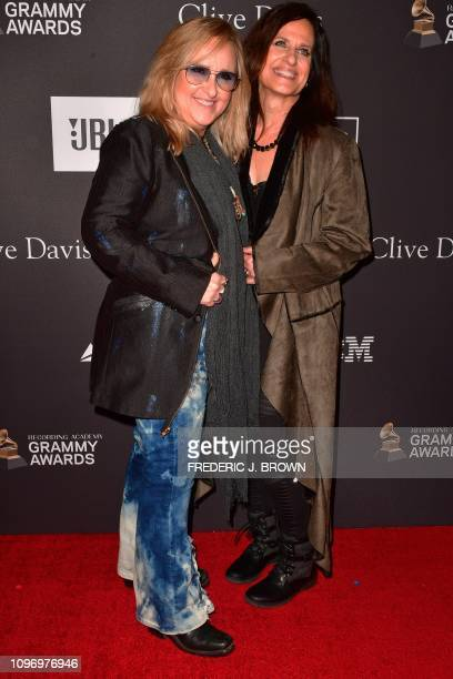 US singersongrwriter Melissa Etheridge and US actress Linda Wallem arrive for the traditional Clive Davis party on the eve of the 61th Annual Grammy...