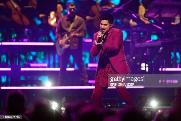 US singersongwriter Adam Lambert performs on stage during the Avicii Tribute Concert For Mental Health Awareness at Friends Arena in Stockholm on...