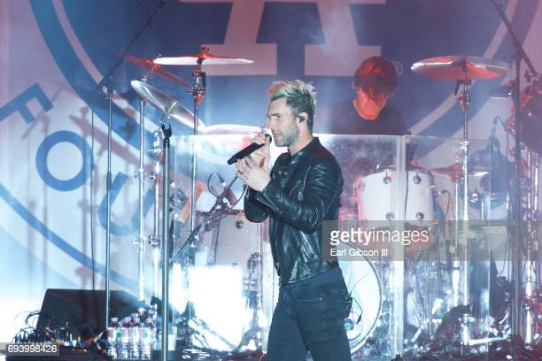 Singer/Songwriter Adam Levine sings and performs with the band Maroon 5 at the Los Angeles Dodgers Foundation's 3rd Annual Blue Diamond Gala at...