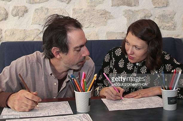 US singersongwriter Alela Diane poses with US musician Ryan Francesconi in Paris on October 13 2015 Diane and Francesconi's collaborative album 'Cold...