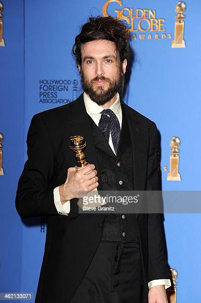 SingerSongwriter Alex Ebert poses in the press room during the 71st Annual Golden Globe Awards held at The Beverly Hilton Hotel on January 12 2014 in...