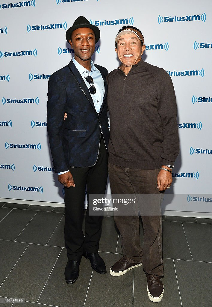 Singer/songwriter Aloe Blacc (L) and singer/songwriter Smokey Robinson visit SiriusXM Studios on October 1, 2014 in New York City.