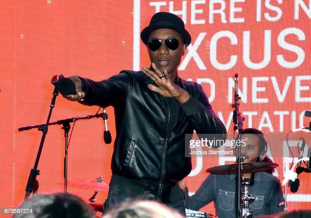 Singer/songwriter Aloe Blacc performs onstage during the GUESS x Peace Over Violence support Denim Day event at Third Street Promenade on April 26...