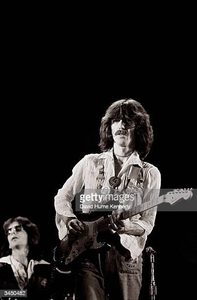 """Singer/songwriter and former Beatles member, George Harrison and band memeber, keyboardist Billy Preston perform on stage during their """"North..."""