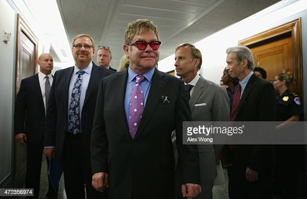 Singer/songwriter and founder of the Elton John AIDS Foundation Elton John and pastor of the Saddleback Church Rick Warren arrive at a hearing before...