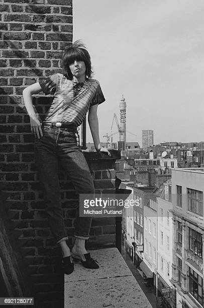 Singersongwriter and guitarist Chrissie Hynde of American rock group The Pretenders standing on a rooftop in London September 1986 The BT Tower can...