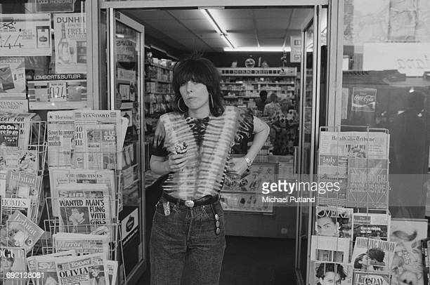 Singersongwriter and guitarist Chrissie Hynde of American rock group The Pretenders holding an ice cream she has just bought in a London newsagent's...