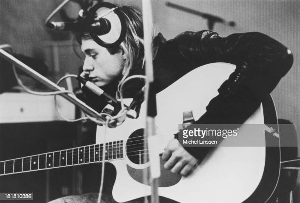 Singersongwriter and guitarist Kurt Cobain of American grunge band Nirvana playing a Takamine acoustic guitar during a recording session at Hilversum...