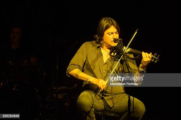 Singersongwriter and multiinstrumentalist Cristiano De André performing during a concert playing the violin Italy 2015