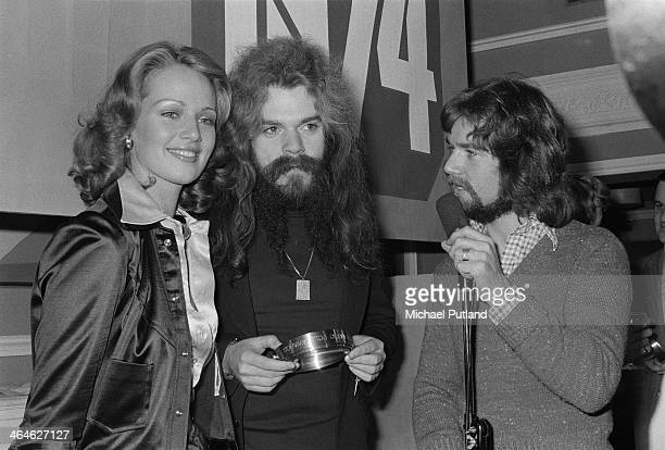 Singersongwriter and musician Roy Wood of English pop group Wizzard with disc jockey Noel Edmonds at the Disc magazine readers' poll awards February...