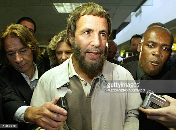 Singersongwriter and peace activist Yusuf Islam formerly known as Cat Stevens speaks to journalists at London's Heathrow airport after being refused...