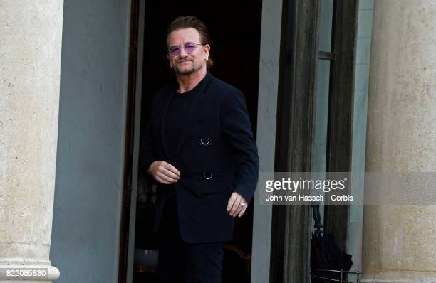 U2 singersongwriter and philanthropist Bono arrives for a meeting with French President Emmanuel Macron at the Elysée Palace on July 24 2017 in Paris...