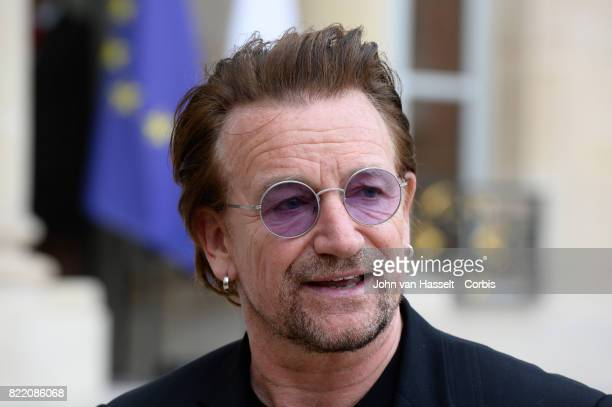 Singer-songwriter and philanthropist Bono speaks to media after attending a meeting with French President Emmanuel Macron at the Elysée Palace on...