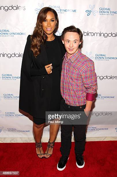 Singer/songwriter and philanthropist Leona Lewis poses for a photo with fashion show model Brandon Gruber at the 2014 Global Down Syndrome...