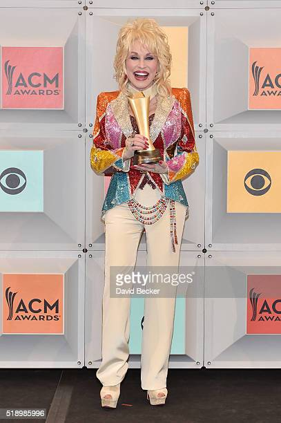 Singersongwriter and producer Dolly Parton winner of the Tex Ritter Award for 'Dolly Parton's Coat of Many Colors' poses in the press room during the...