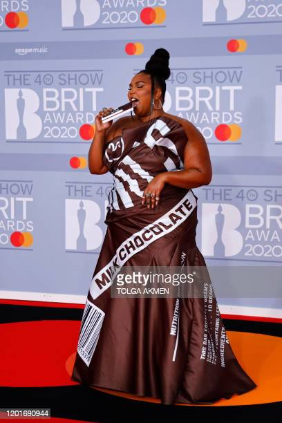 US singersongwriter and rapper Lizzo poses on the red carpet on arrival for the BRIT Awards 2020 in London on February 18 2020 / RESTRICTED TO...