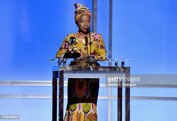 Singer/songwriter Angelique Kidjo accepts an award onstage during the GRAMMY PreTelecast at The 58th GRAMMY Awards at Microsoft Theater on February...