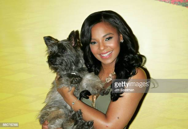 """Singer/songwriter Ashanti and Nigel attend the """"There's No Place Like Home"""" dog adoption day at New York City Center on May 30, 2009 in New York City."""