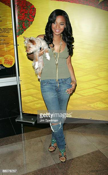 """Singer/songwriter Ashanti holds a adoption dog Willis at the """"There's No Place Like Home"""" dog adoption day at New York City Center on May 30, 2009 in..."""