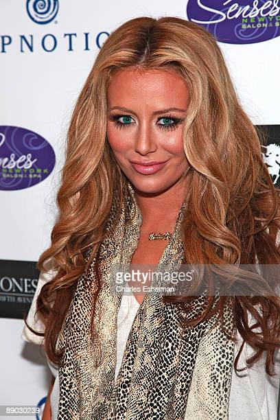 Singer/songwriter Aubrey O'Day attends the opening of Friday Jones Fifth Ave Tattoo Studio at Senses NY Salon Spa on July 14 2009 in New York City