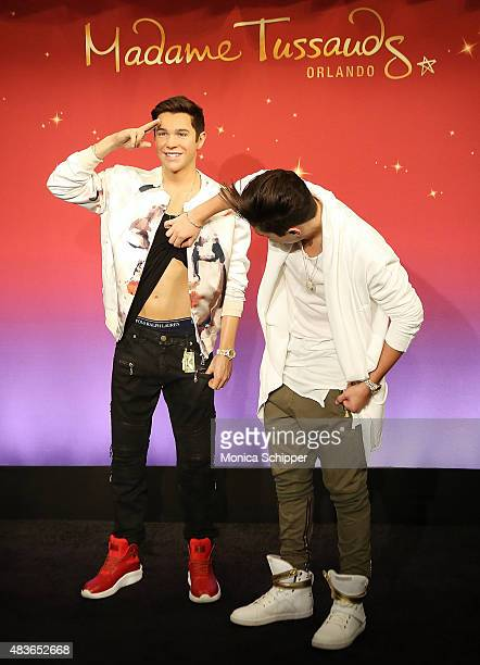 Singersongwriter Austin Mahone Meets His New Madame Tussauds Wax Figure at Madame Tussauds on August 11 2015 in New York City