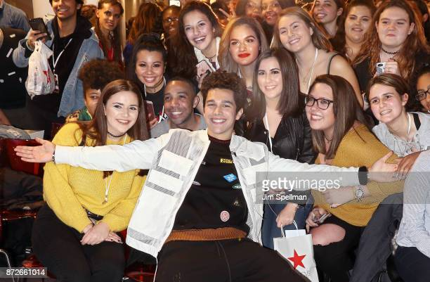 Singer/songwriter Austin Mahone poses with fans during his visit to Macy's Herald Square at Macy's Herald Square on November 10 2017 in New York City