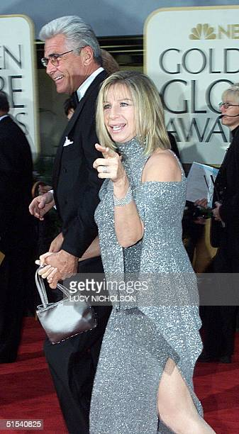US singer/songwriter Barbra Streisand arrives with her husband James Brolin at the 57th Annual Golden Globe Awards in Beverly Hills CA 23 January...