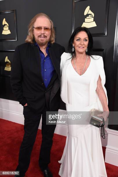Singersongwriter Barry Gibb of the Bee Gees and Linda Gray attend The 59th GRAMMY Awards at STAPLES Center on February 12 2017 in Los Angeles...