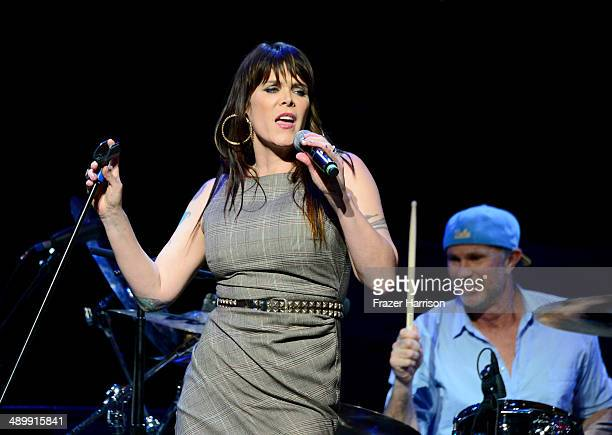 Singersongwriter Beth Hart and drummer Chad Smith perform onstage at the 10th annual MusiCares MAP Fund Benefit Concert at Club Nokia on May 12 2014...