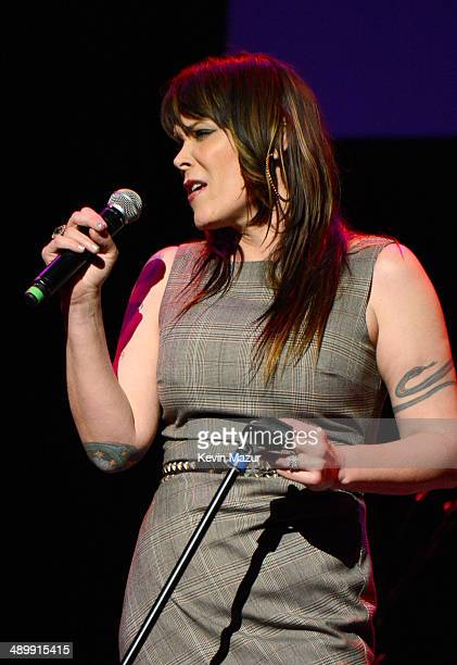 Singer/songwriter Beth Hart performs at the MusiCares MAP Fund Benefit Concert at Club Nokia on May 12 2014 in Los Angeles California