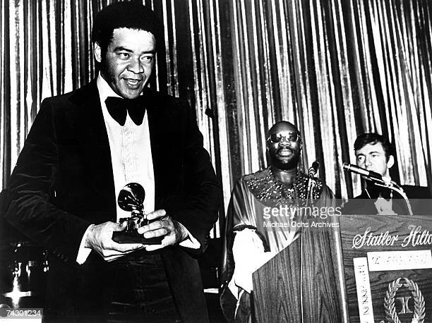 "Singer/songwriter Bill Withers gets presented a Grammy for ""Best Rhythm & Blues Song"" for his hit ""Ain't No Sunshine"" by singers Isaac Hayes and..."