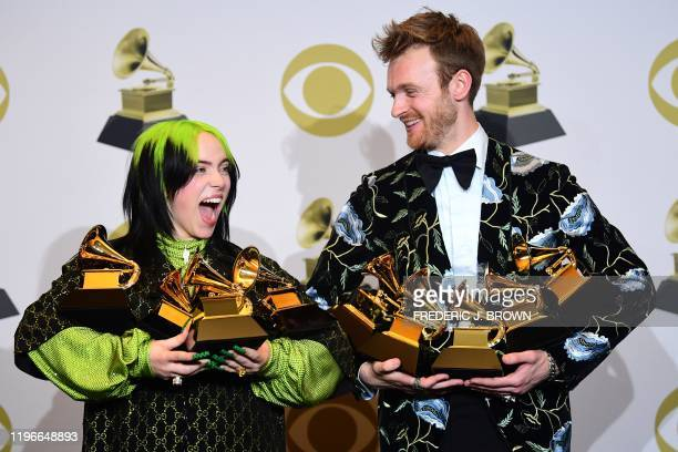 TOPSHOT US singersongwriter Billie Eilish and Finneas O'Connell pose in the press room with the awards for Album Of The Year Record Of The Year Best...